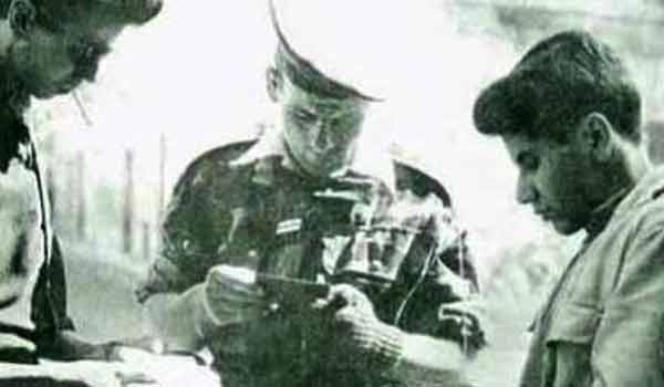 Legionnaire of the 1er REP checking papers during the Battle of Algiers in 1957